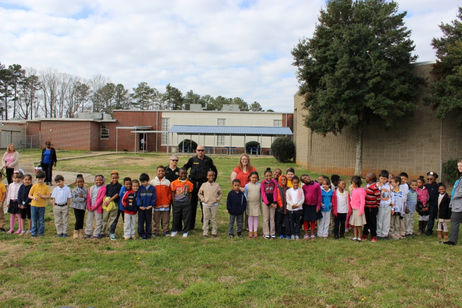 First Grade Poses with the Officers during Career Day